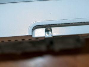 Remove right hand screw near paper tray