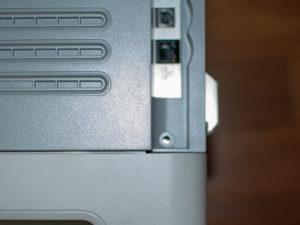 Remove screw near network ports